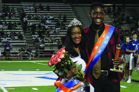 Seniors Esosa Oyemense and Briannah Collier are crowned Homecoming King and Queen at a game against Jesuit.