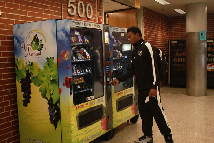 Student decides on the $1.25 fruit snacks during his 6th period class. The vending machines have been updated to include healthy snacks.