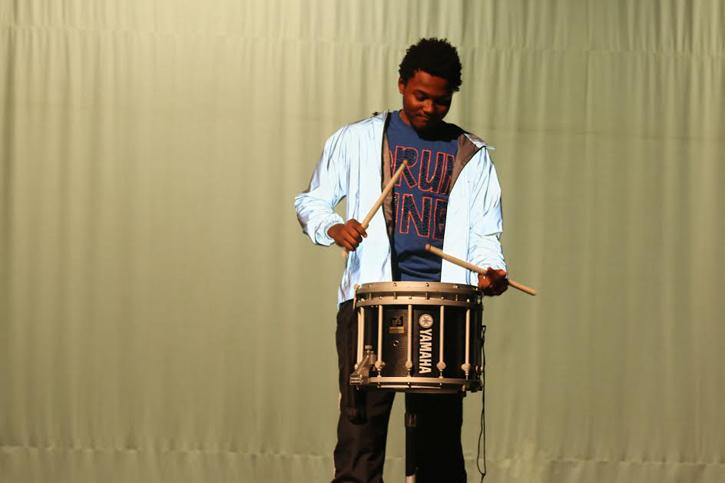 Senior Brandon Kitchin playing the drums during his routine.