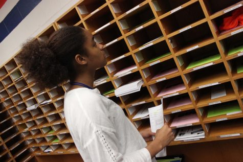 Senior Janaye Payne hard at work as an office aide.