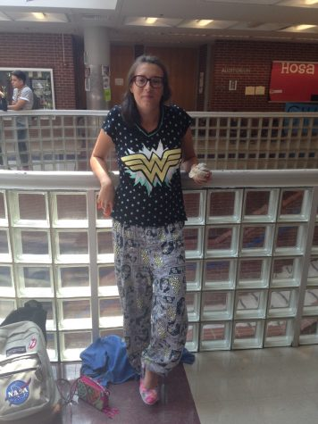 Senior Sarah Godfrey rocking out in her Wonder Woman P.J.s duirng Pajama Day.