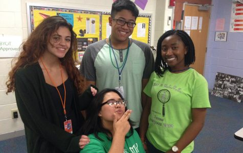 Seniors Ashley Cauthen, Peter Su, Madison Nguyen Ester Abaraoha dressed in their Green attire for Green Day.