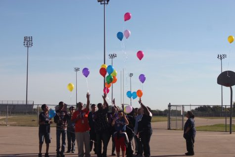 The Special Education department and their students release balloons  for a lost teacher that lost her life by getting hit by a vehicle.