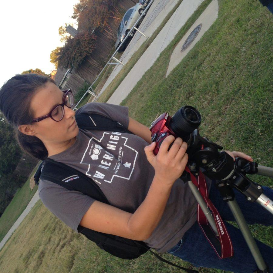 IB Senior Sarah Godfrey, sets up her camera to film part of her short film, her IB Film internal assessment.
