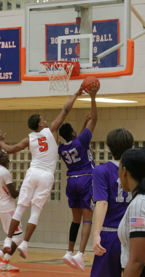 Donoven Davenport blocked a easy layup by Paschal during a blow out with of 74-43.