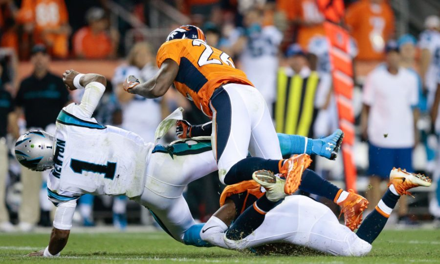 Sep 8, 2016; Denver, CO, USA; Carolina Panthers quarterback Cam Newton (1) is hit by Denver Broncos free safety Darian Stewart (26) in the fourth quarter at Sports Authority Field at Mile High. Mandatory Credit: Isaiah J. Downing-USA TODAY Sports