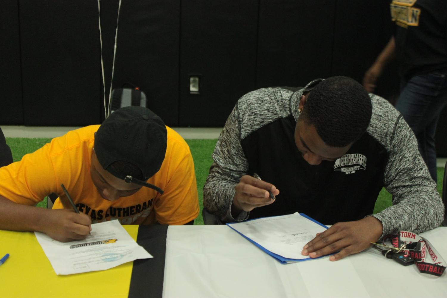 Khari+Clarkson+and+Nick+Caruthers+both+signed+their+scholarship+to+Texas+Lutheran+University.
